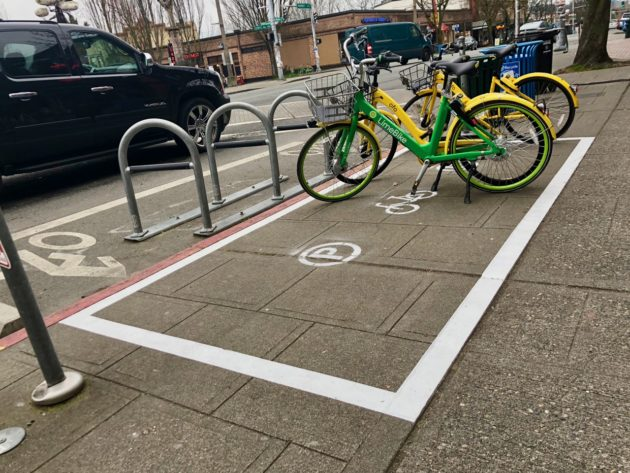 Do shared bikes need their own parking spaces? Seattle tests designated zones on sidewalks