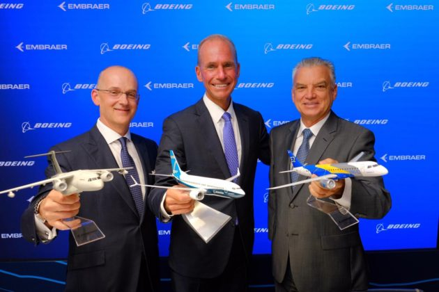 Boeing and Embraer executives