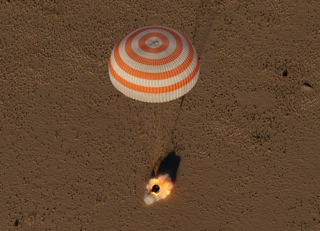 U.S.-Russian trio returns to Earth from space station on Sputnik anniversary