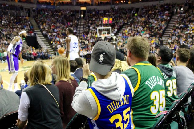 7ce2814a29cf6 Basketball fans donned Kevin Durant jerseys old and new on Friday night at  KeyArena as they watched the Golden State Warriors star play in Seattle for  the ...