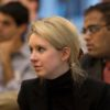 Elizabeth Holmes, the chief executive officer and founder of Theranos, a health care technology company, listens as Deputy Secretary of Defense Ash Carter speaks at Stanford University in Palo Alto, Calif., April 17, 2013. (DoD photo by Glenn Fawcett/Released)
