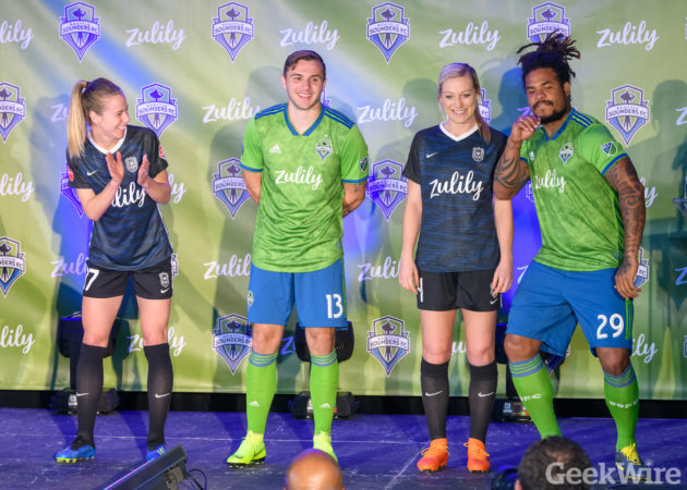 2e9ffec45 Seattle Sounders and Reign FC players have a little fun on stage at the  unveil of their new Zulily branded jerseys. (GeekWire Photo   Kevin Lisota)