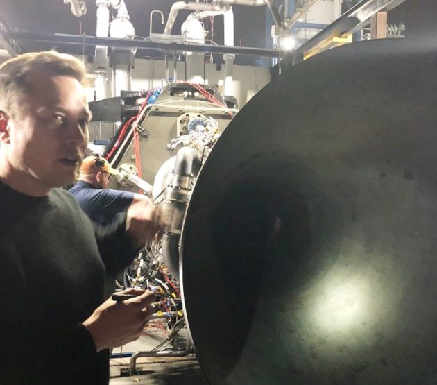 Elon Musk with rocket engine