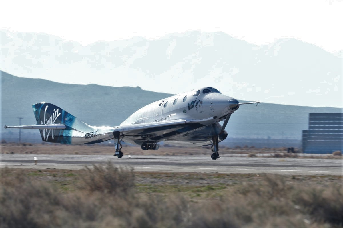 SpaceShipTwo rocket plane carries three people for first ...