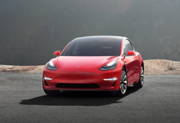 Tesla starts selling $35,000 Model 3 cars and shifts to