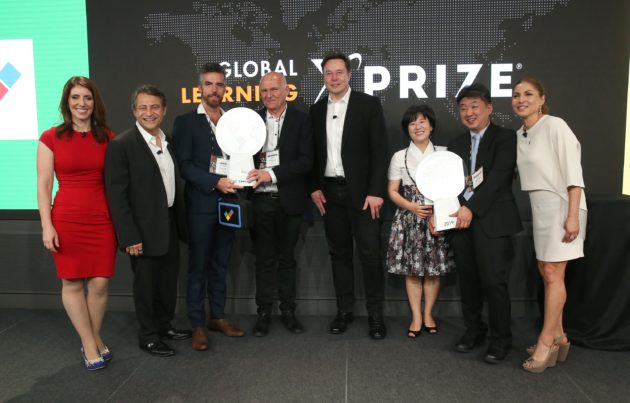 Elon Musk with XPRIZE executives and winners
