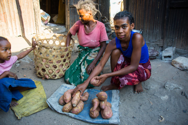 Photo Credit Josh Callow - Albertine (MGB16237) sells sweet potatos with her mother from her home in Mahajanga after her first surgery with Mercy Ships.