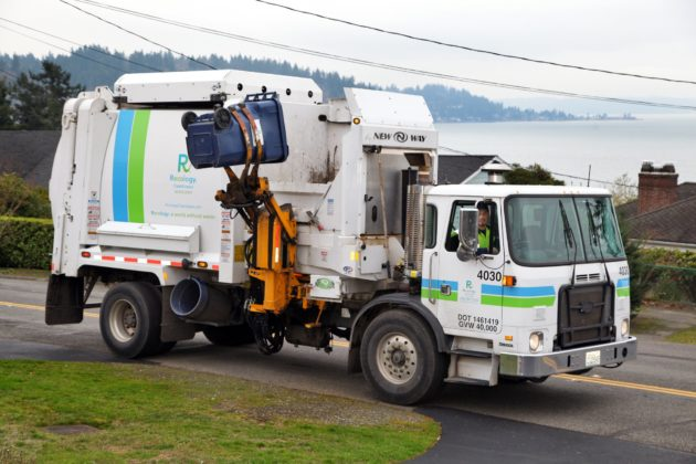 Seattle rolls out electric garbage trucks in pioneering transition away from fossil fuels