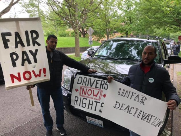 Uber and Lyft drivers roll up to Seattle City Hall to demand