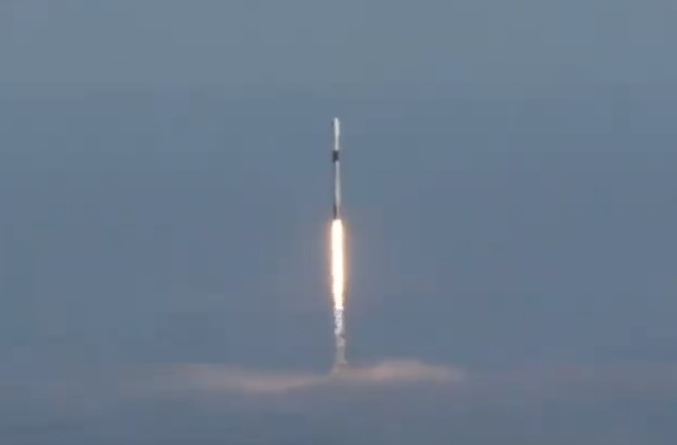 SpaceX launches Radarsat constellation, with booster returning for foggy landing