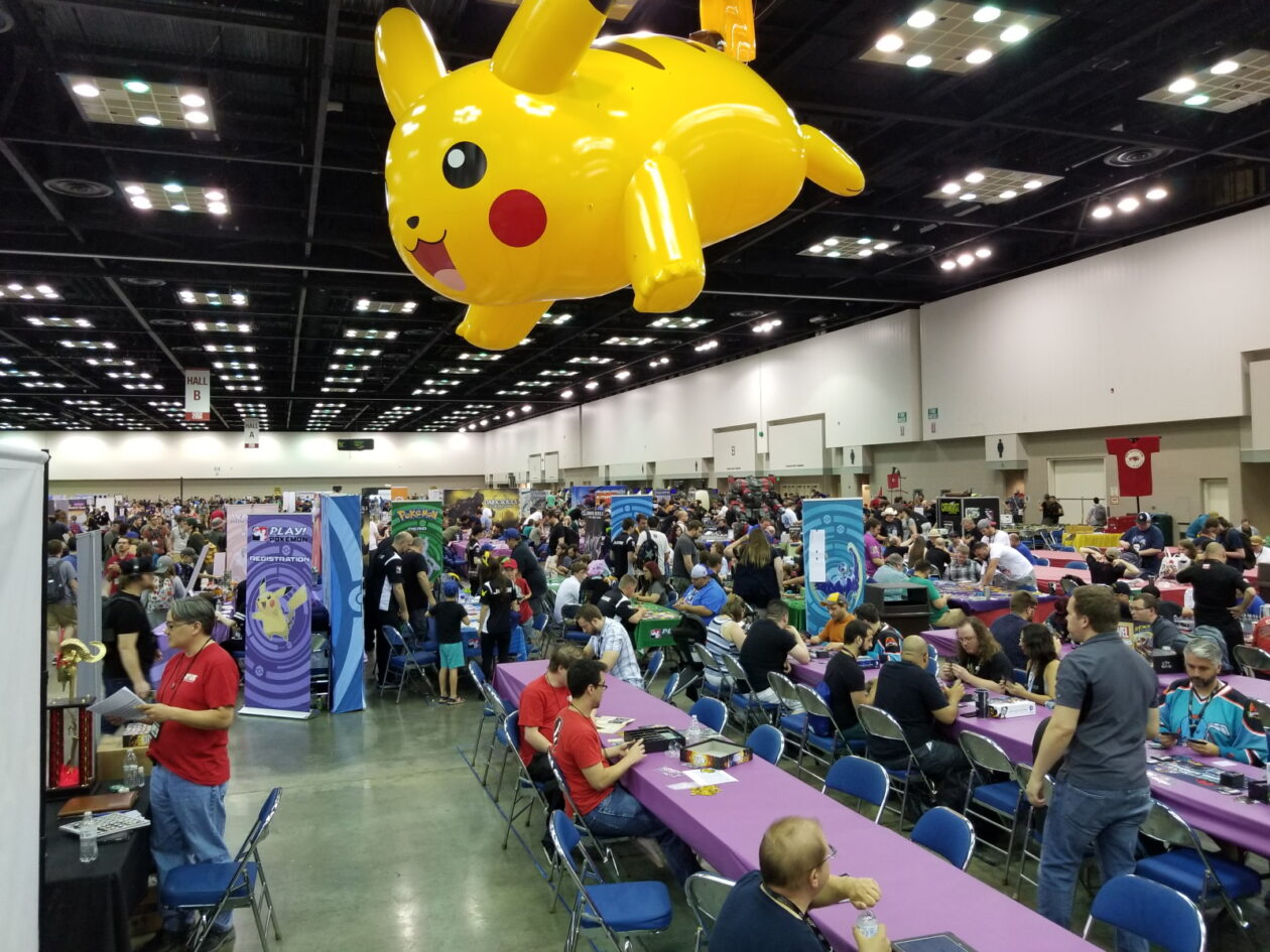 An enormous Pikachu hangs over the game demo tables at Gen Con.