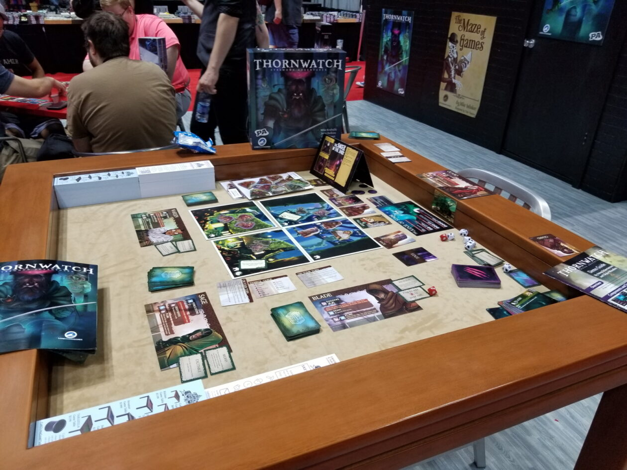 A vendor at Gen Con displays the Penny Arcade board game Thornwatch
