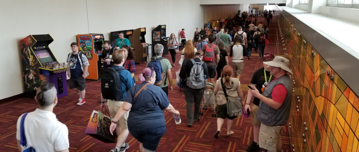 A hallway lined with arcade games at Gen Con.