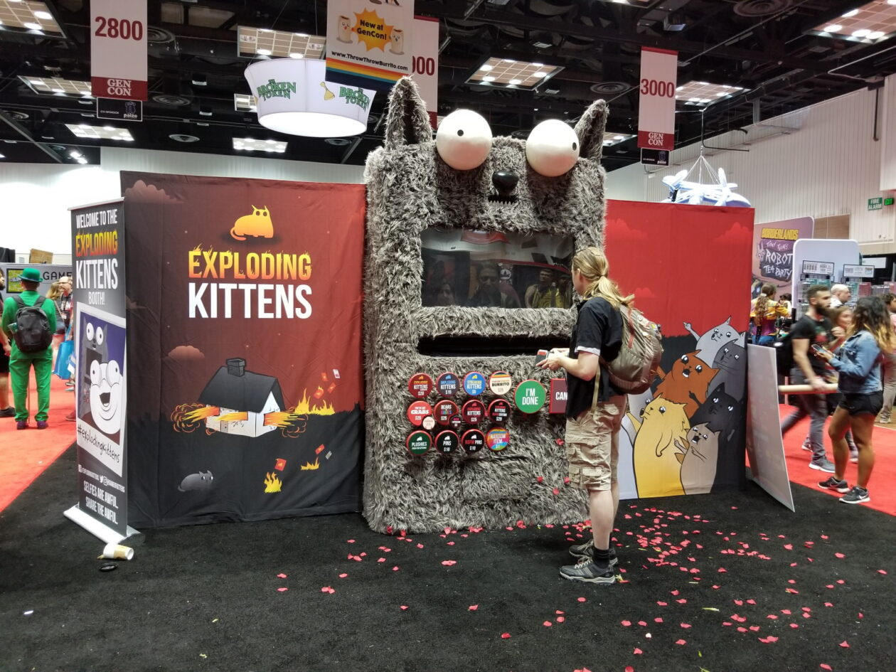 "The popular mass market card game ""Exploding Kittens"" had a giant cat display handing out prizes"