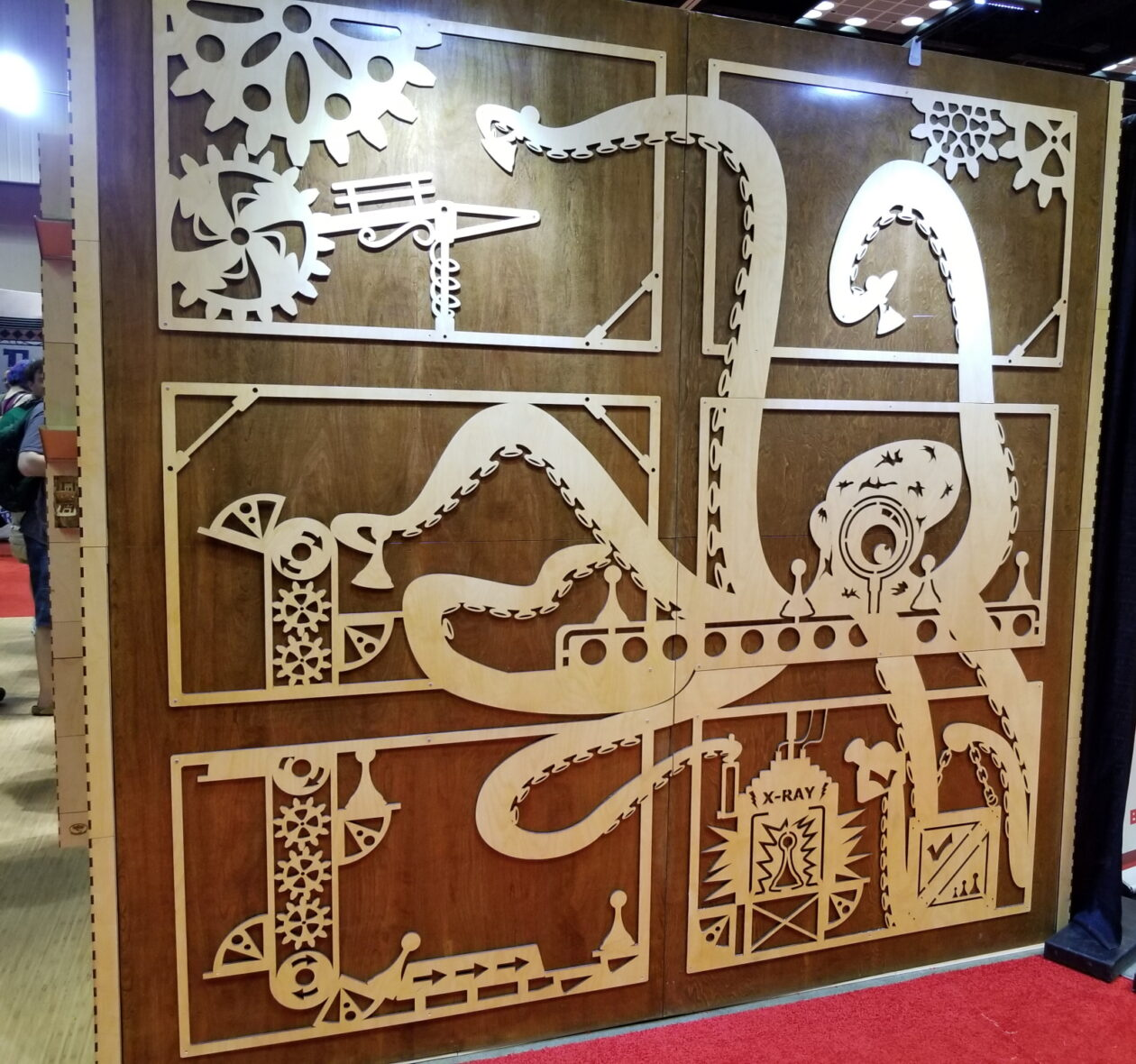 A large laser-cut octopus scientist display at Gen Con