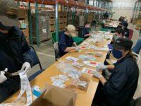 Assembling coronavirus test kits