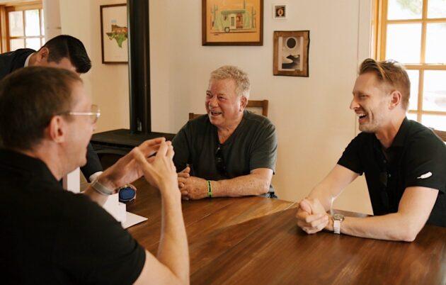William Shatner and future shipmates sitting around Astronaut Village table